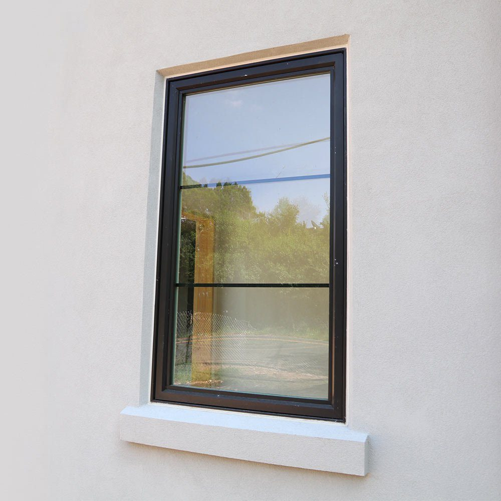 A recessed window sealed with liquid flashing | Construction Pro Tips
