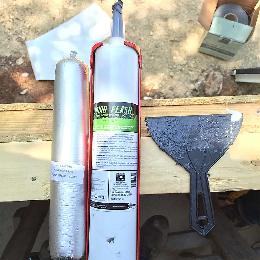 A tube of liquid flashing, an applicator and a scraper for application | Construction Pro Tips