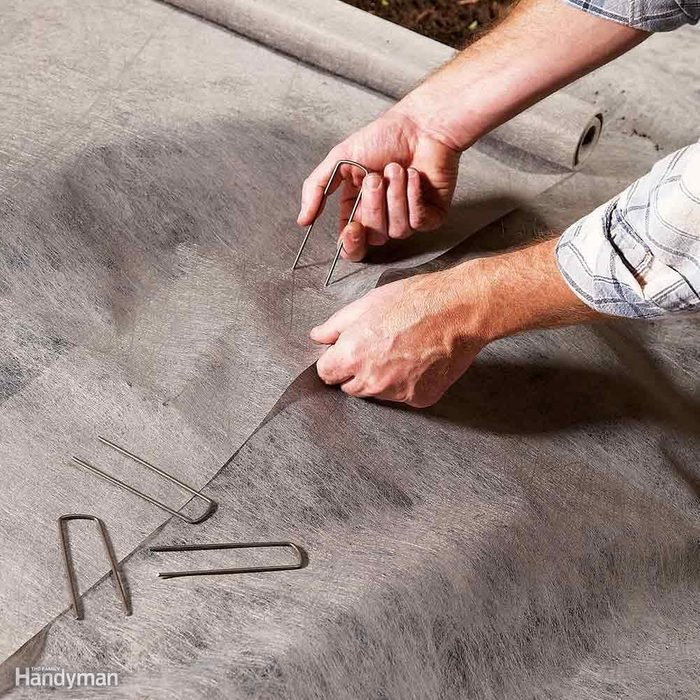 Use Landscape Fabric Staples to Anchor the Seams
