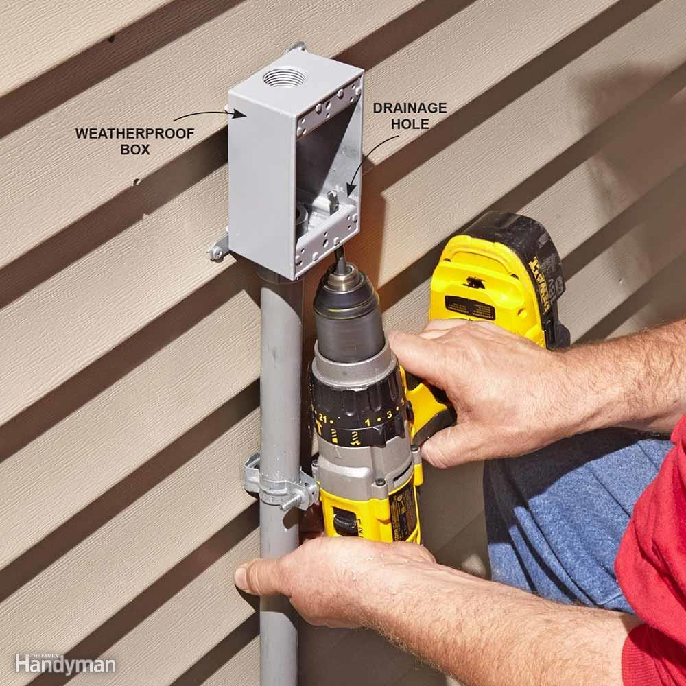 Installing Pvc Conduit The Family Handyman Pipeelectric Wire Protection Tubeblack Vinyl Tube Buy Electric Drill A Hole In Electrical Box To Let Water Out