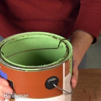 Use a Bent Coat Hanger to Keep Paint Cans Clean