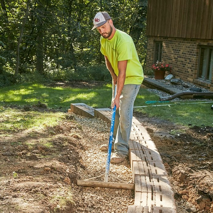 Backfilling the trench with gravel fill   Construction Pro Tips