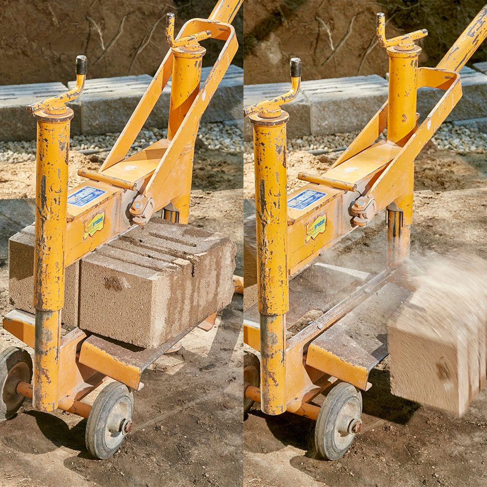 A machine splitting retaining wall blocks in half | Construction Pro Tips