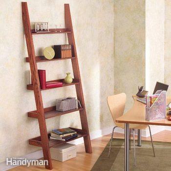 wooden ladder bookshelf stands on a wall