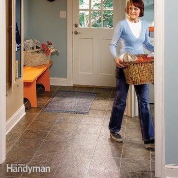 installing new vinyl flooring in a laundry room
