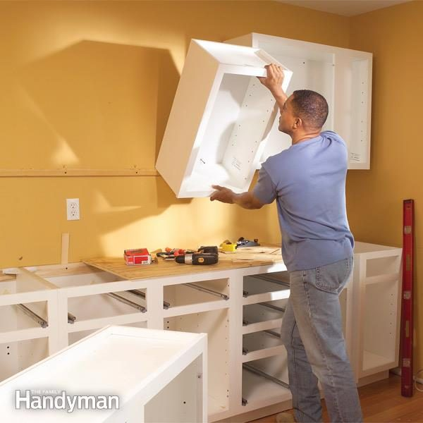 how to install upper kitchen cabinets how to install kitchen cabinets the family handyman 17081