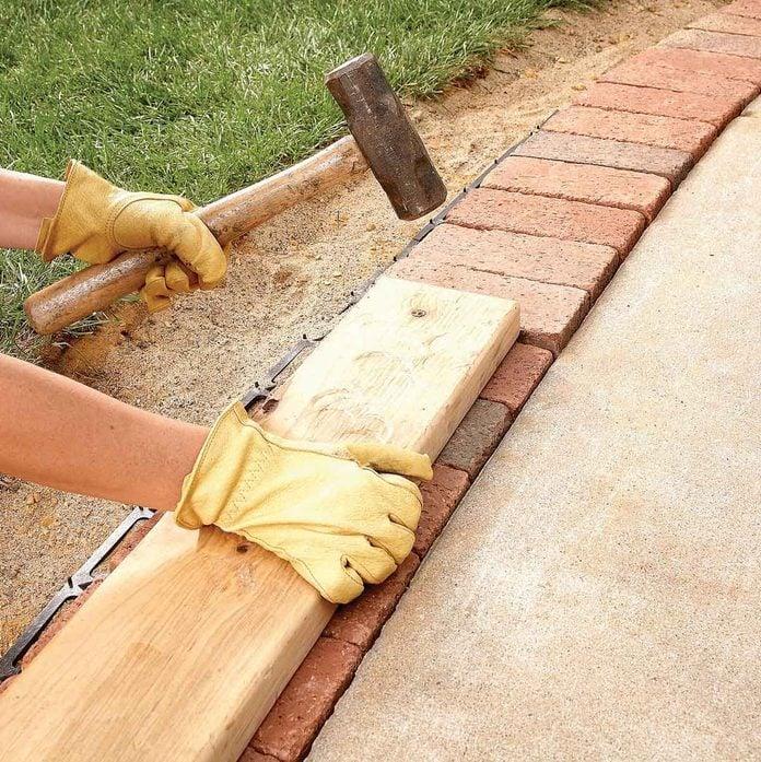 tamp the bricks