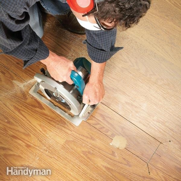 Laminate Floor Repair The Family Handyman - What do i put under laminate flooring