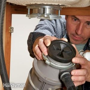How to Replace a Garbage Disposer Splash Guard
