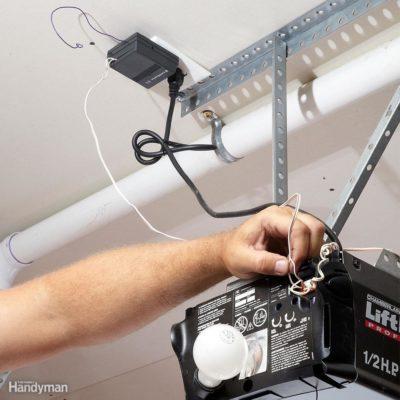 man attempts a repair to a Liftmaster garage door opener