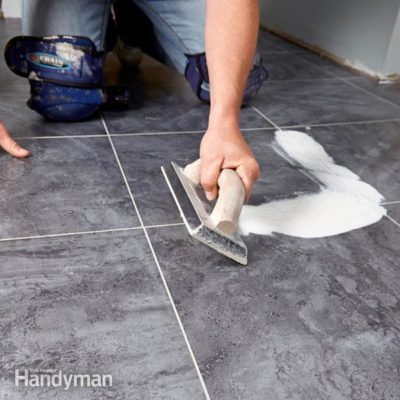 Groutable vinyl tile