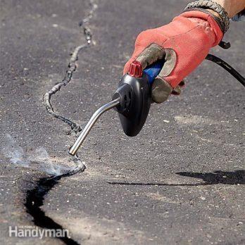 How to seal an asphalt driveway the family handyman asphalt repair and crack filling solutioingenieria Choice Image
