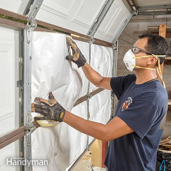 Exactly how to insulate a garage door the family handyman fh16djainsula01 2 insulated garage doors insulating a garage solutioingenieria Choice Image