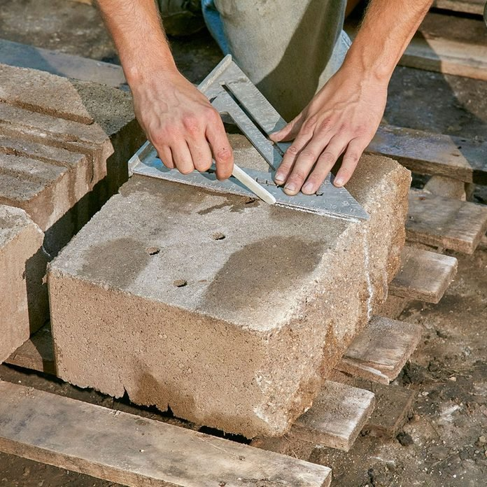 Tracing a line onto a stone block   Construction Pro Tips
