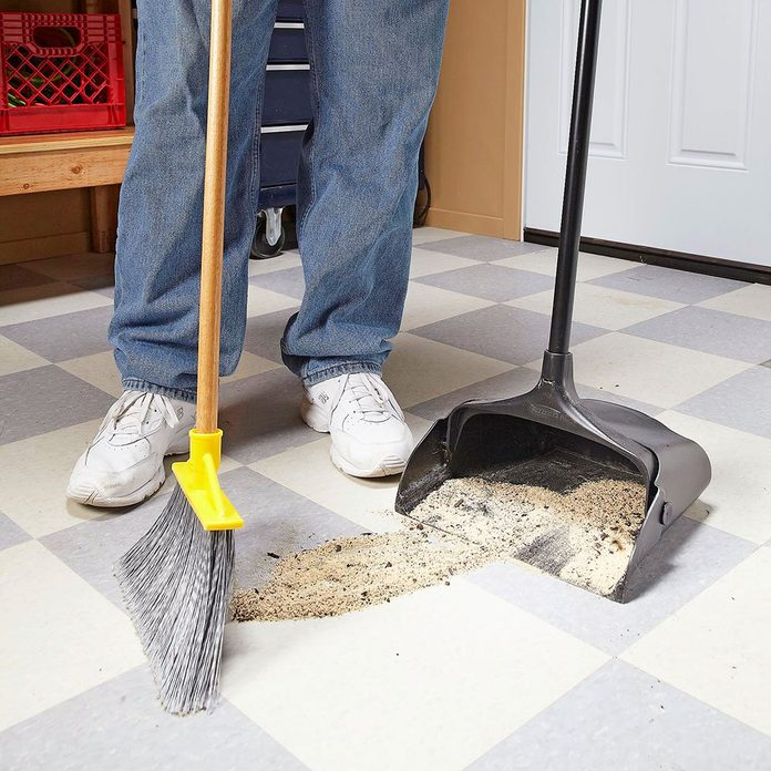 Sweeping up dust and sand into a dustbin | Construction Pro Tips
