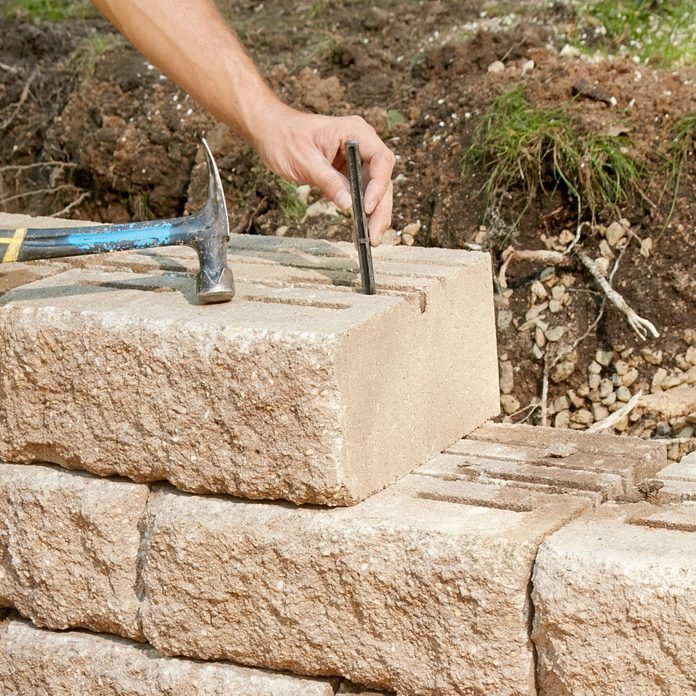 Adding a versa lock to a retaining wall block   Construction Pro Tips