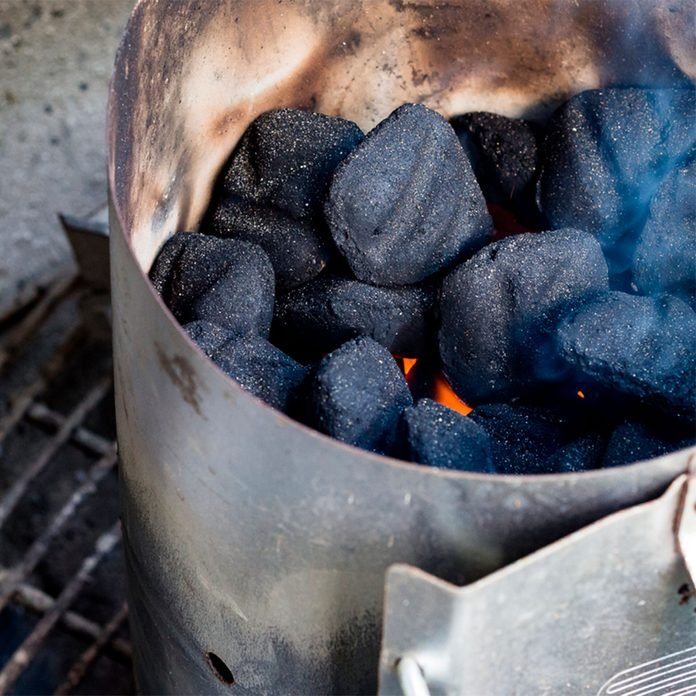 charcoal chimney with close-up of lit coals