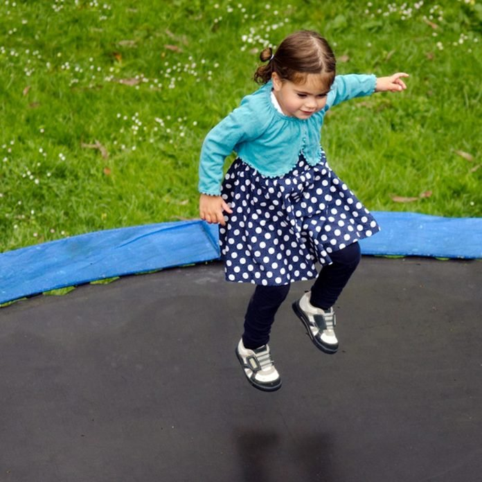 little girl jumping on trampoline safety
