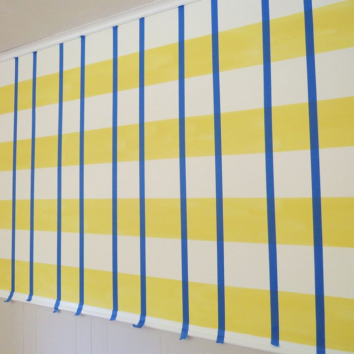 tape vertical strips for gingham wall