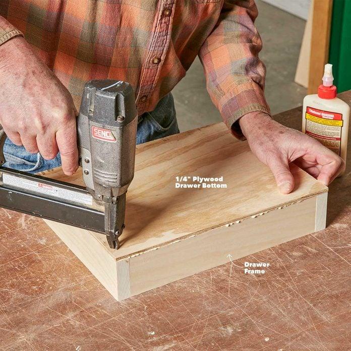attach the under-cabinet drawer bottom