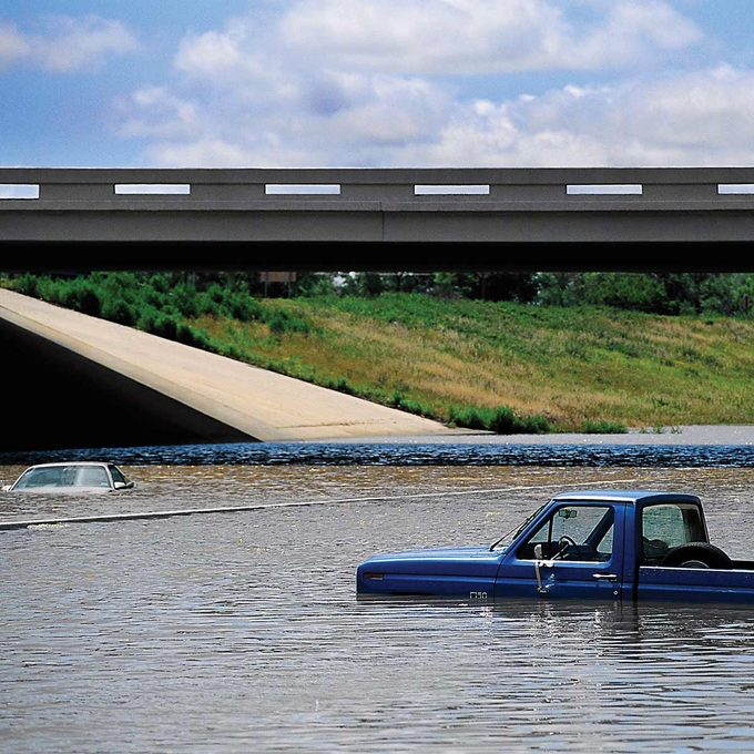 car pick-up truck in water flood