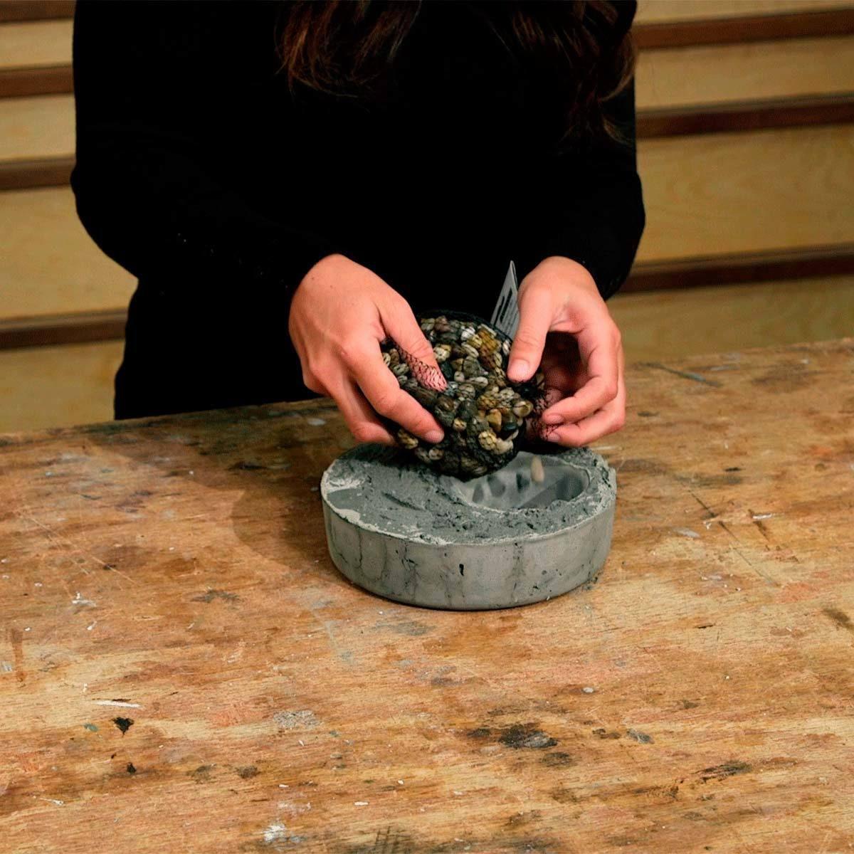 add pebbles to air plant planter