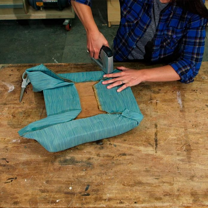 staple new fabric to seat