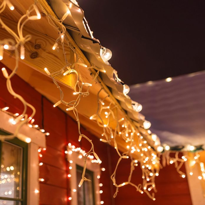 outdoor string lights on house around windows christmas lights