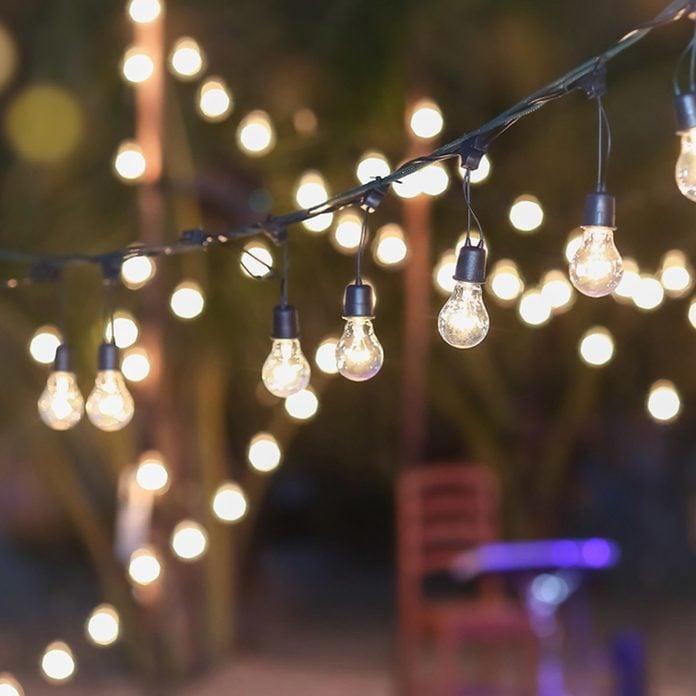 outdoor string lights Edison bulbs make shift canopy