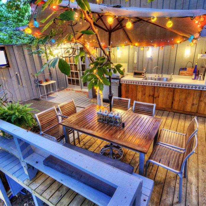 Lights and Torches outdoor patio string lights deck