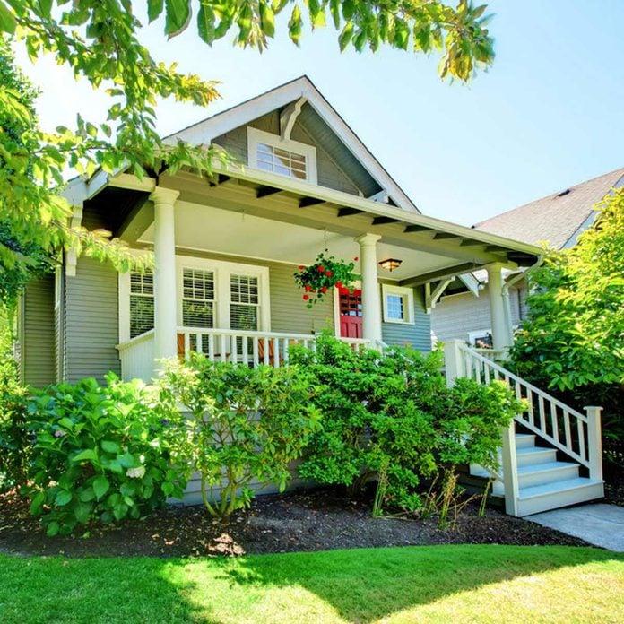 bungalow craftsman light green exterior siding front porch