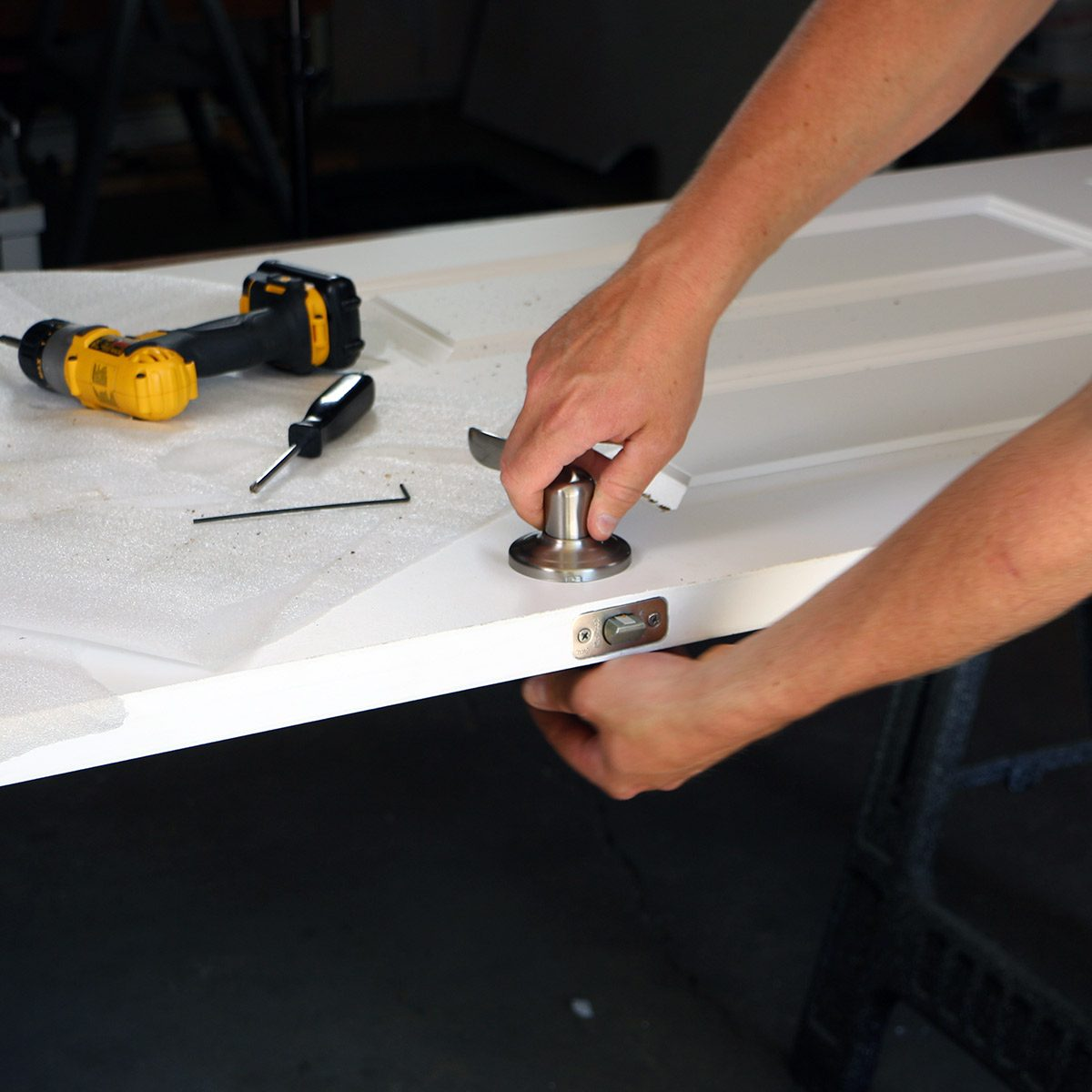 install the door latch and lever