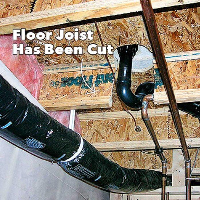 floor joist has been cut beneath toilet
