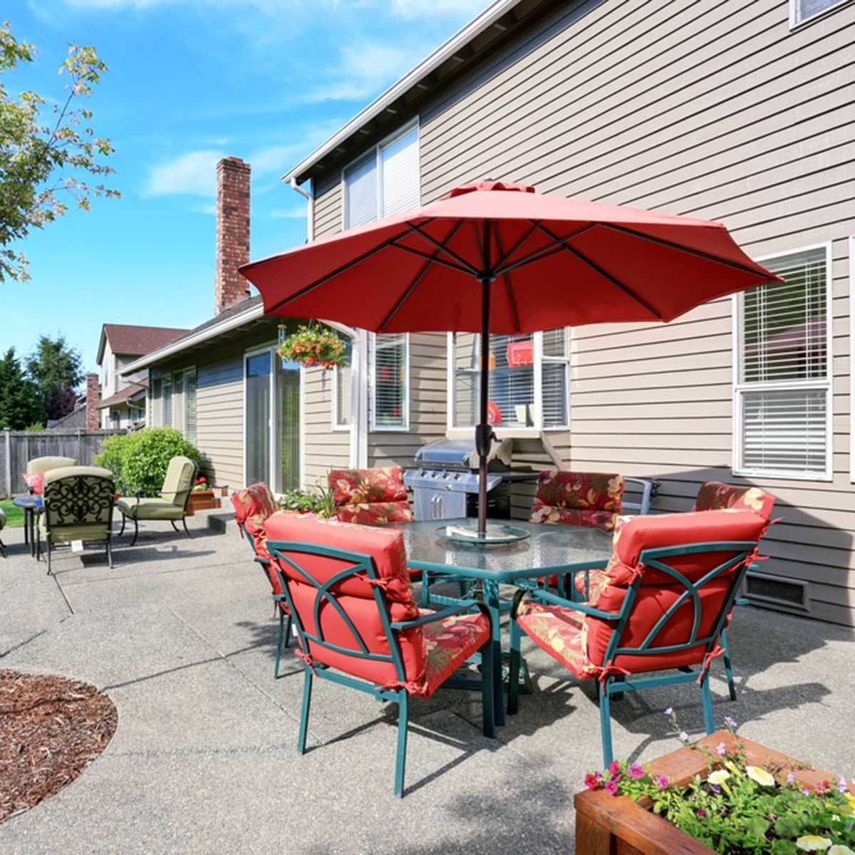 Use Table Umbrellas For Roomy, Level Patios