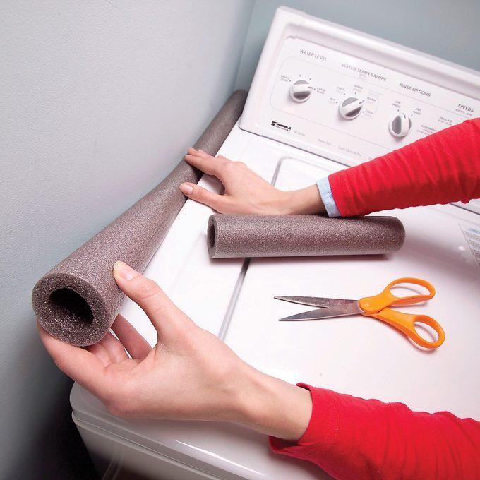 foam pipe insulation next to washing machine laundry room laundry hack