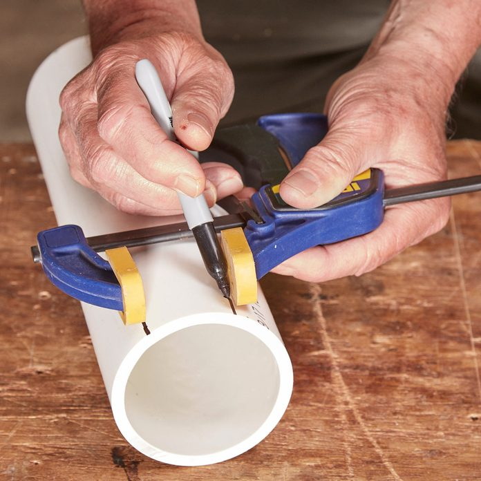 measure pvc pipe with clamp and sharpie