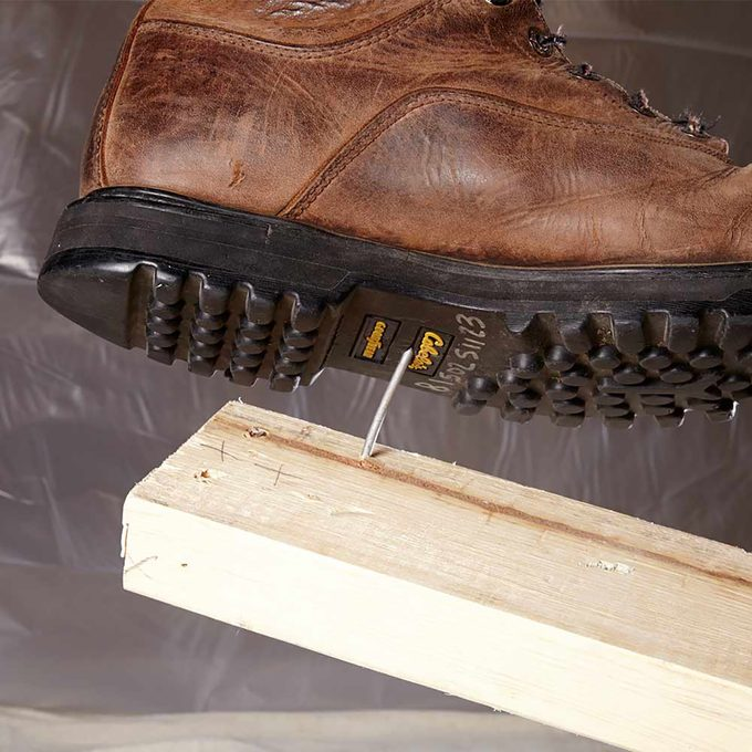 Nail poking up towards the exposed sole of a boot   Construction Pro Tips
