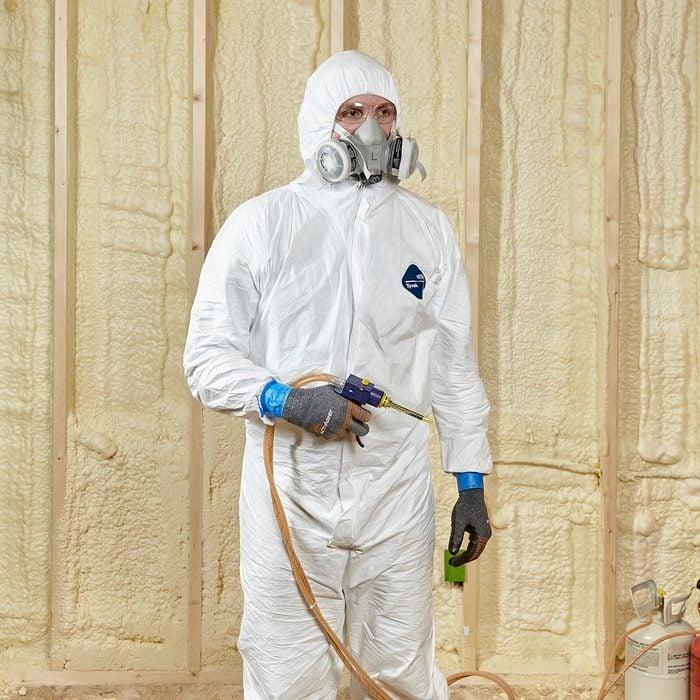 Man wearing proper spray-foaming gear | Construction Pro Tips