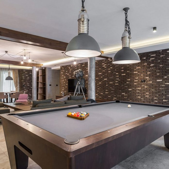 dfh17aug016_shutterstock_360392798-game room pool table with stone brick veneers