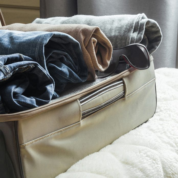 suitcase storage clothes rolled up