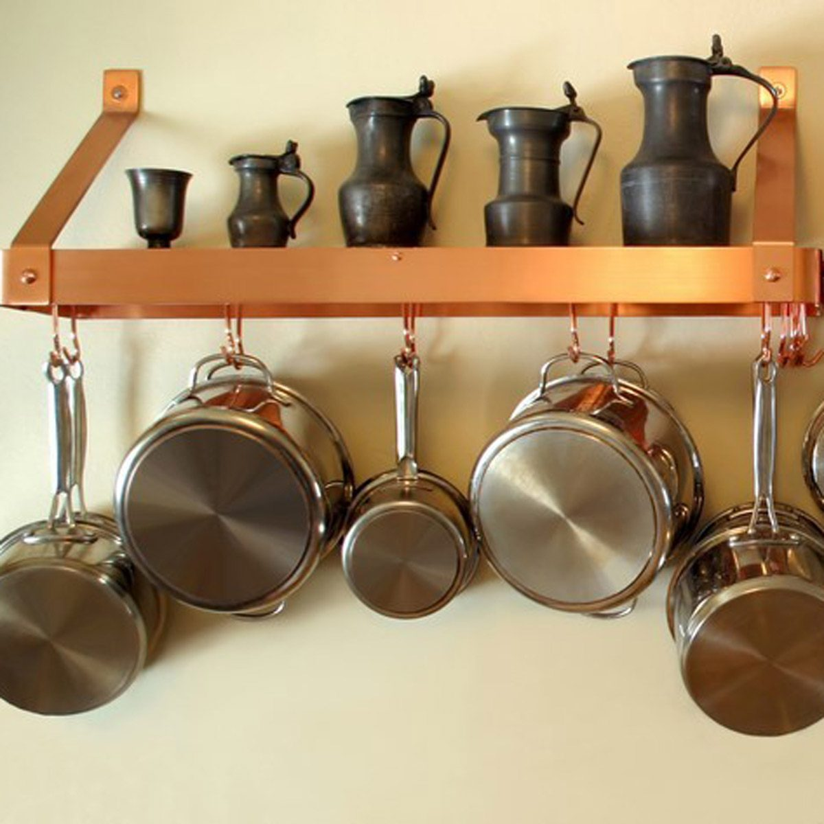 Hang pots and pans under a shelf or cupboard