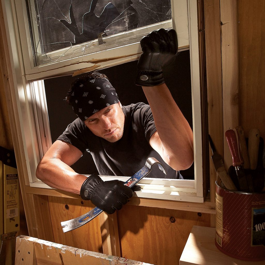 Man breaking into a garage through a window | Construction Pro Tips