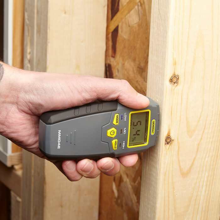 Poking wood with a moisture meter | Construction Pro Tips