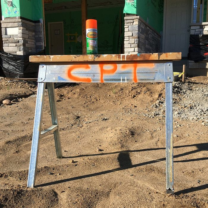 A sawhorse marked with CPT in spraypaint | Construction Pro Tips