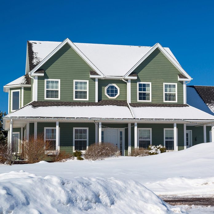 shutterstock_299270855-1200x1200 home covered in snow winter house