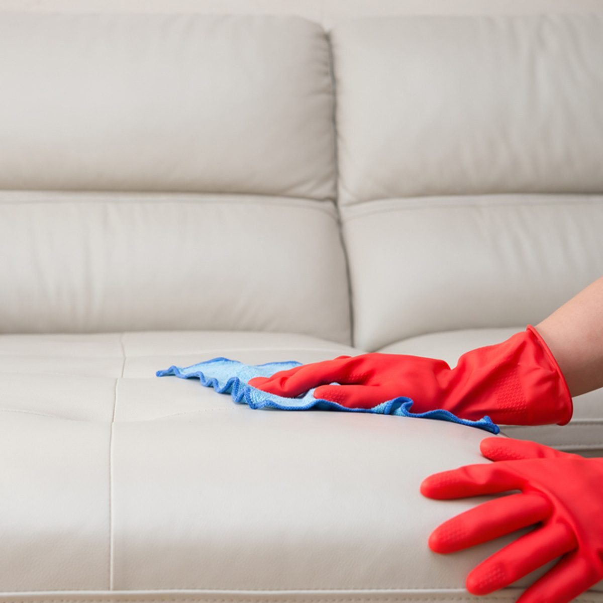 shutterstock_435822565 cleaning leather furniture rubber gloves