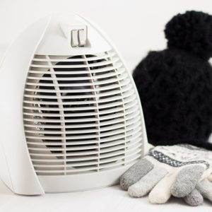 shutterstock_522624481 space heater with mittens and hat