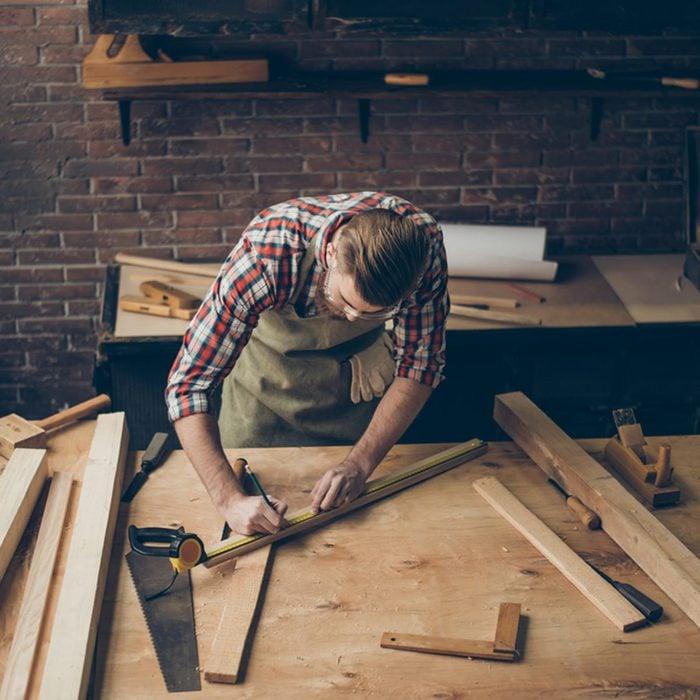 shutterstock_578729953 unfinished basement woodworking work shop