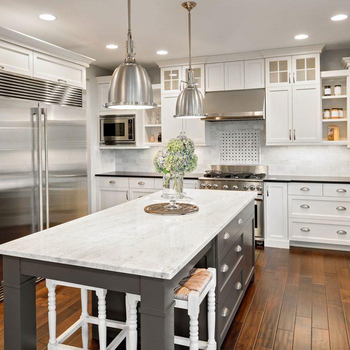 17oct85_250878214_01 kitchen lighting pendants island white cabinets marble countertop kitchen center island