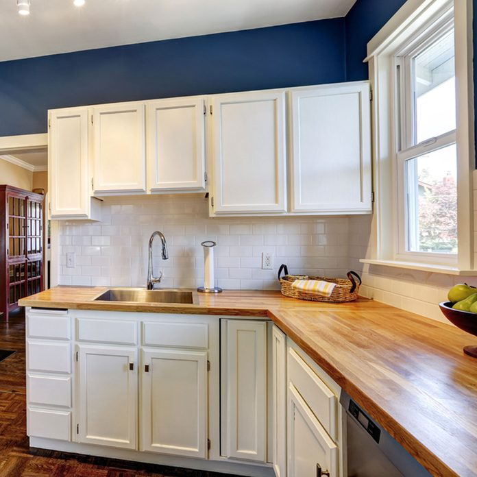 17oct912018_206792290_07 blue kitchen with white cabinets butcher block counter tops